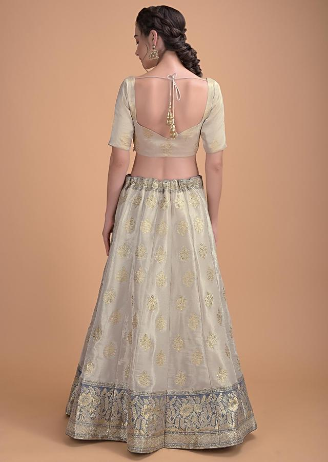 Sand Beige Lehenga Choli In Brocade Silk With Weaved Floral Buttis Online - Kalki Fashion