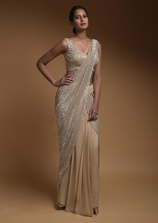 Sand Beige Ready Pleated Saree In Crepe With An Attached Pallu In Crushed Sequins Fabric And Ruffle Hem Online - Kalki Fashion