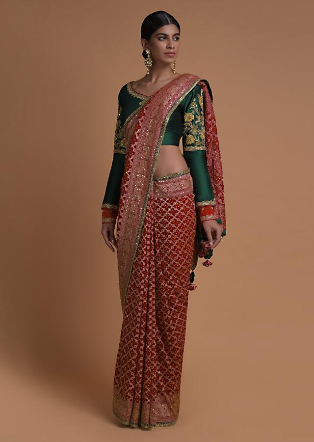 Scarlet Red Saree With Bandhani Print And Weaved Checks Along With Fancy Emerald Green Blouse Online - Kalki Fashion