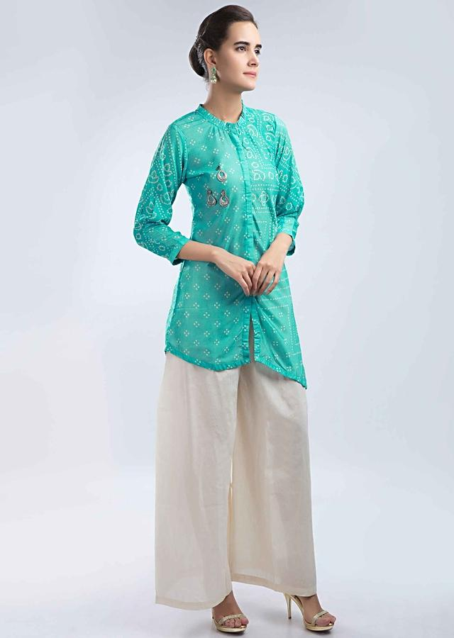 Sea Green Top In Bandhani Print With Contrasting Cream Palazzo Online - Kalki Fashion
