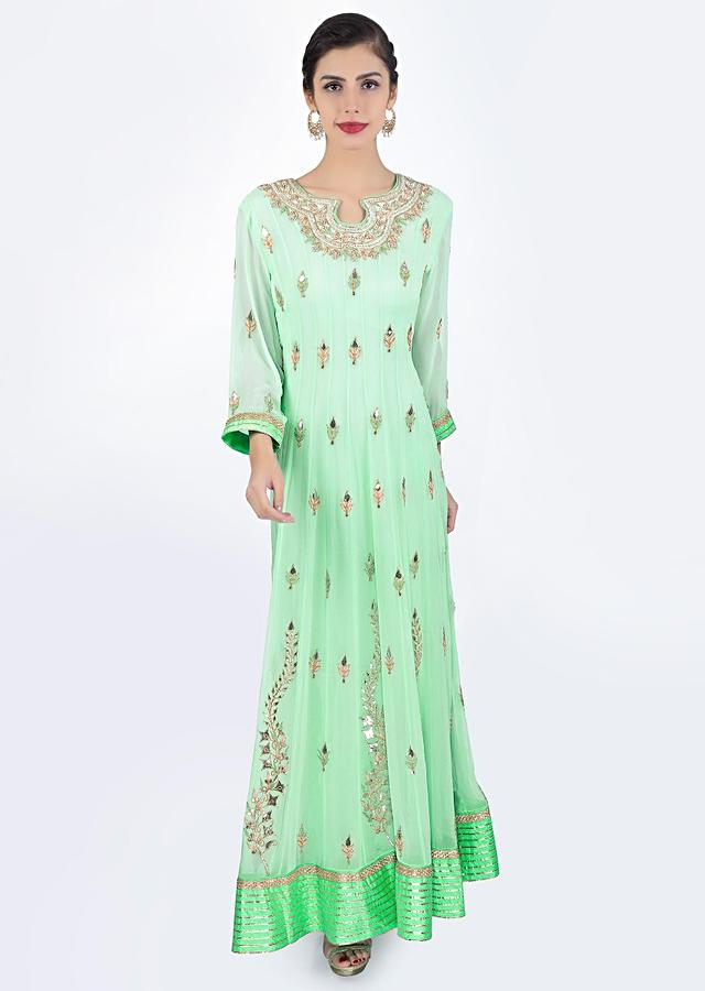Sea green georgette anarkali dress paired with matching chiffon net dupatta only on Kalki