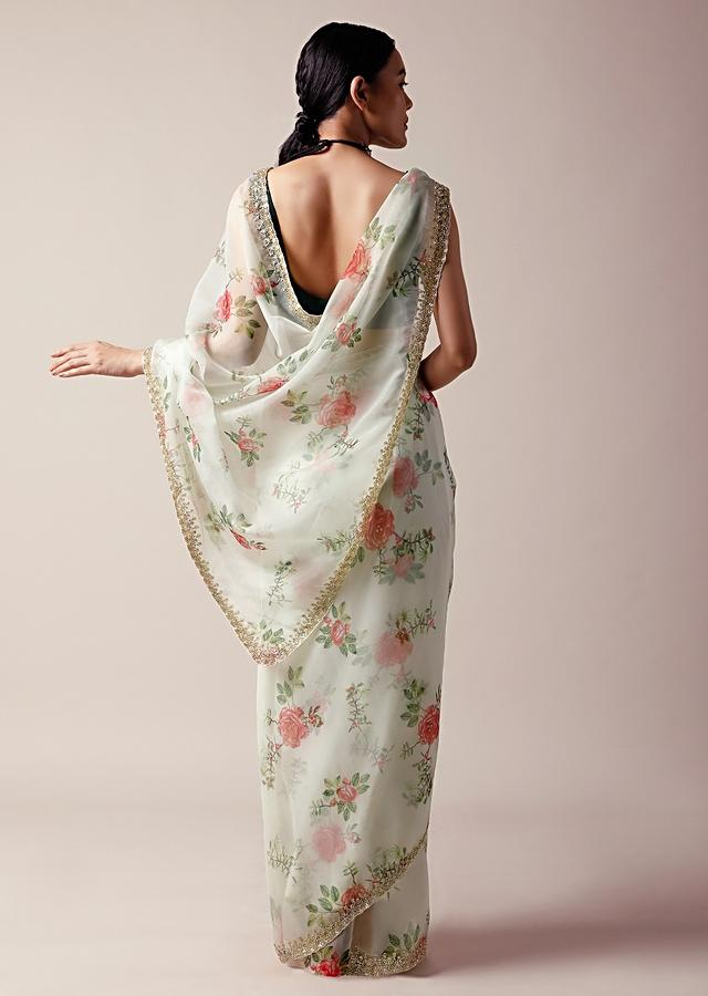 Off white Saree In Organza With Floral Print And Cut Dana Work Along With Unstitched Blouse Online - Kalki Fashion