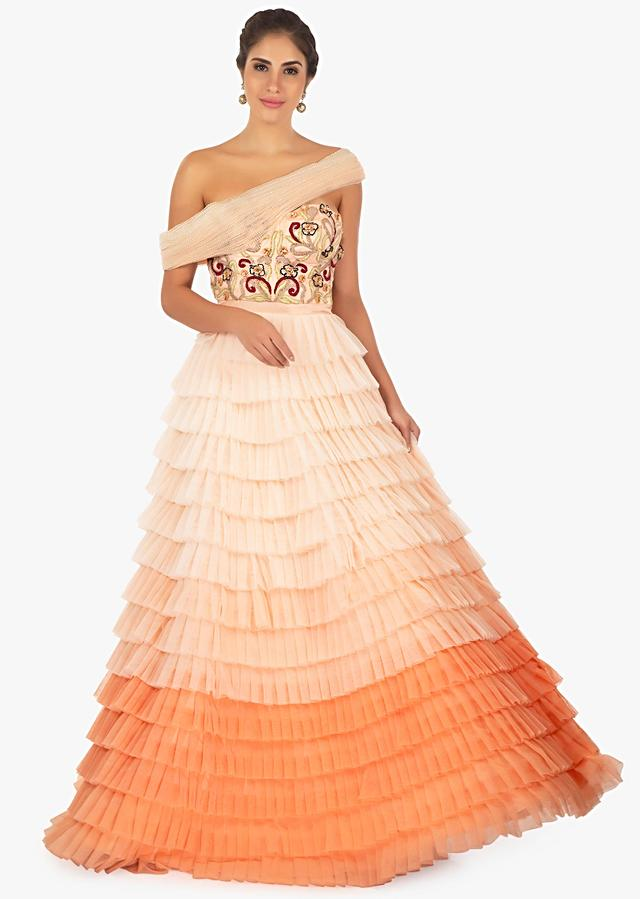 Shaded peach gown featuring in 3 D flowers and resham embroidery  only on Kalki