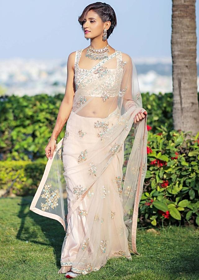 Shakti Mohan in Kalki powder pink net saree with floral embroidered butti