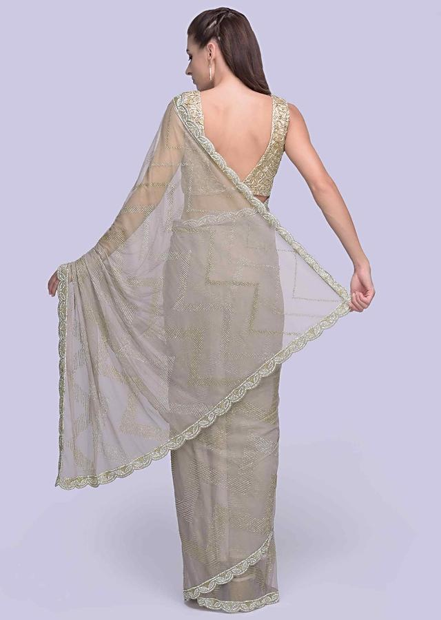 Grey Saree In Sheer Net Embellished With Cut Dana And Stone Detailing Online - Kalki Fashion