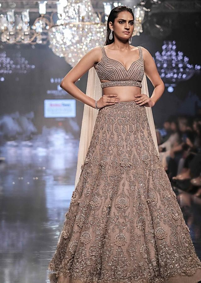 Shell Champagne Lehenga Hand Crafted In Heavy Embroidered Net In Floral Motifs Online - Kalki Fashion