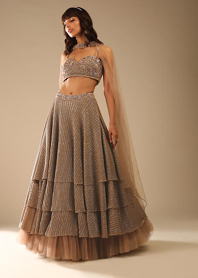 Taupe Layered Sequins Lehenga With Net Frill On The Hem And Cut Dana Embroidered Choli And Choker Dupatta Online - Kalki Fashion