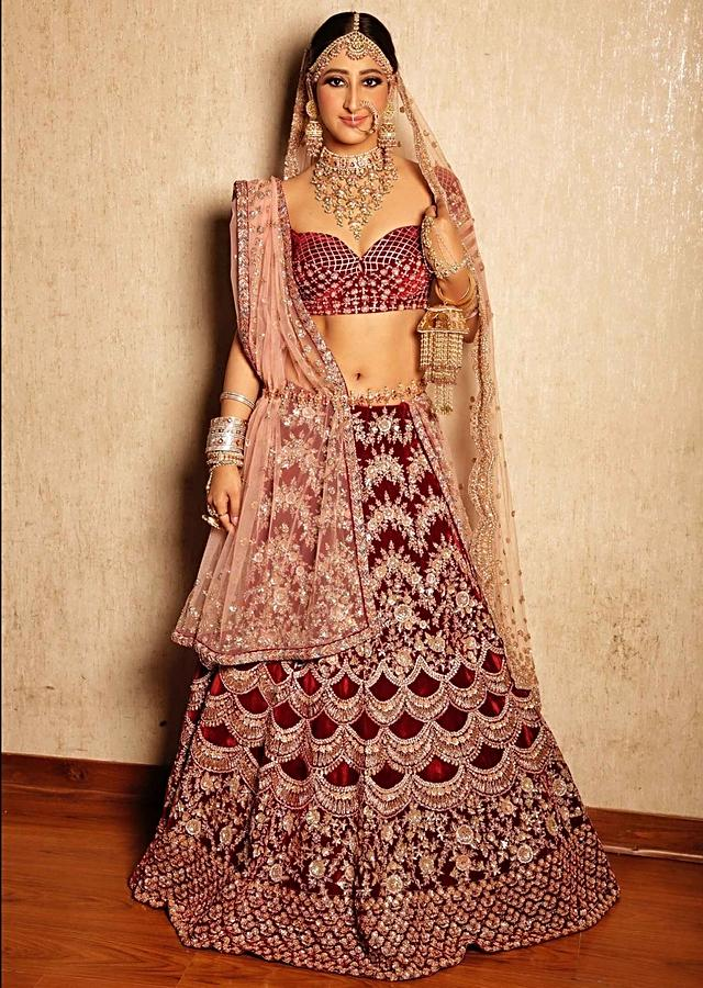 Shivya Pathania in Kalki Maroon velvet heavy embroidered lehenga with pink net dupatta