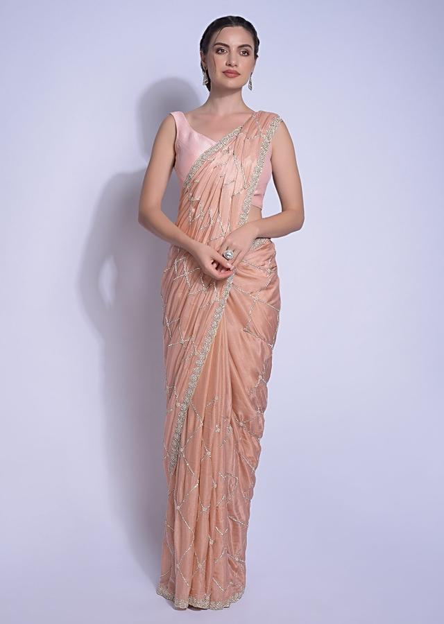 Shrimp Peach Saree Embellished With Checks And Floral Pattern Online - Kalki Fashion