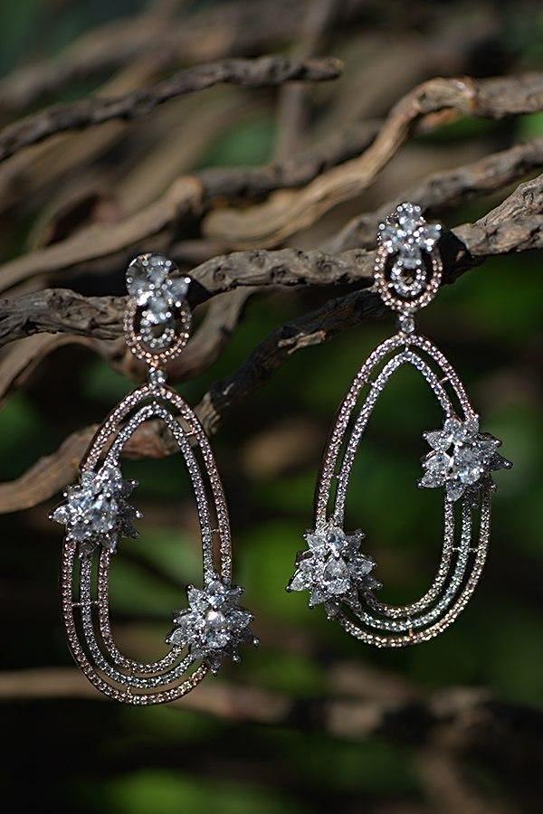 Silver And Rose Gold Plated Contemporary Earrings With Crystal Embellished Flowers Kohar By Kanika
