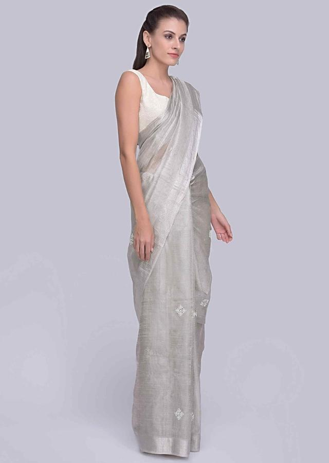 Silver grey jute silk saree with white moti and cut dana embroidery and butti only on Kalki