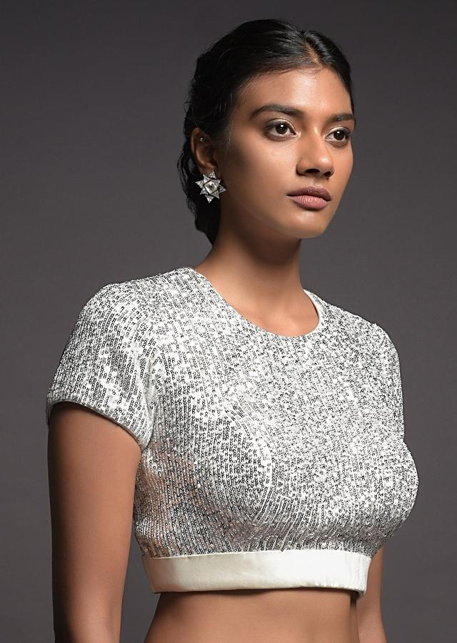 Silver White Blouse In Sequins Fabric With Satin Hemline And Cap Sleeves Online - Kalki Fashion