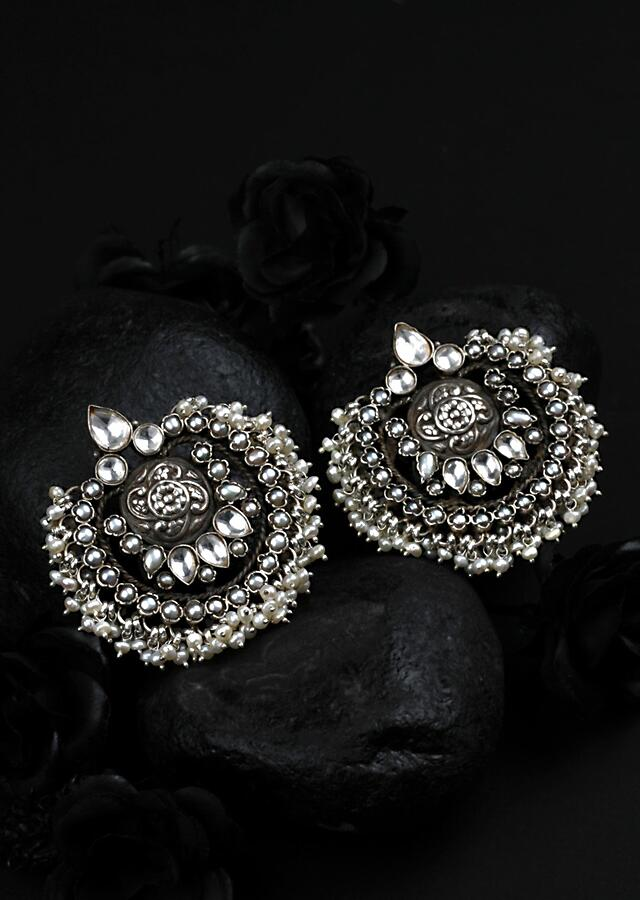 Silver Hand Crafted Earrings With Carved Floral Pattern And Dangling Beads Made In Sterling Silver By Sangeeta Boochra