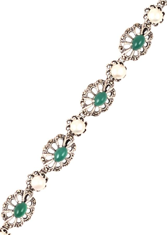 Silver Plated Bracelet With Carved Flowers And Embellished With Green Gemstone And Pearls Made In Sterling Silver By Sangeeta Boochra