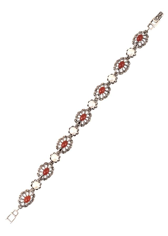Silver Plated Bracelet With Carved Flowers And Embellished With Orange Gemstone And Pearls Made In Sterling Silver By Sangeeta Boochra