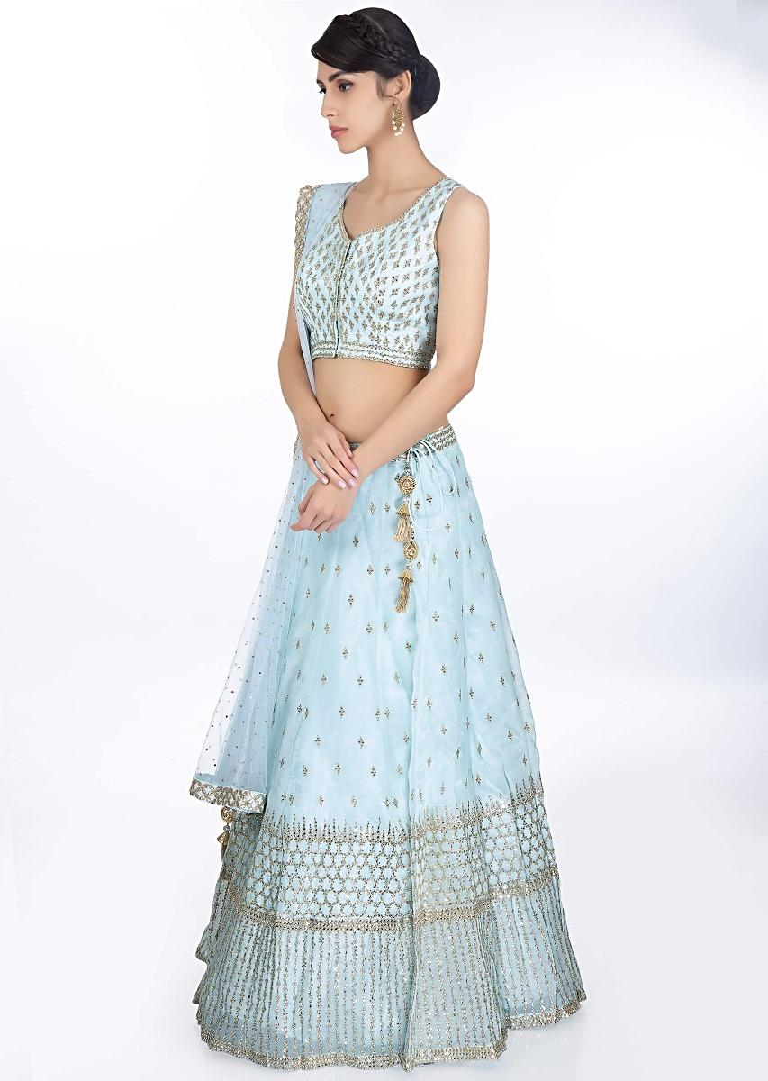 c7ea49f2d9233 Sky blue organza lehenga in zari and kundan embroidery paired with a matching  blouse and net dupatta only ...
