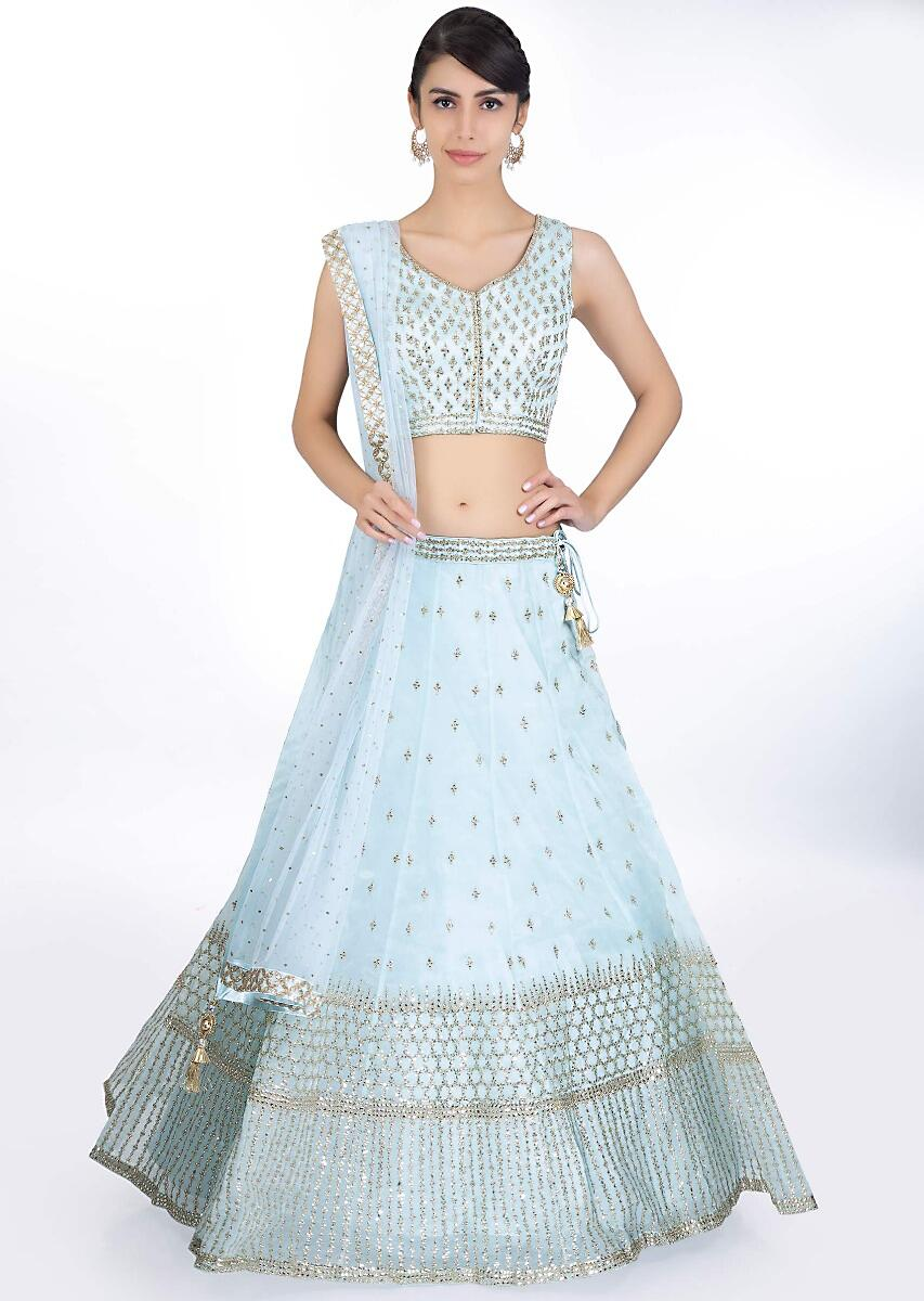 39b9b0be02b74 Sky blue organza lehenga in zari and kundan embroidery paired with a matching  blouse and net dupatta only on KalkiMore Detail