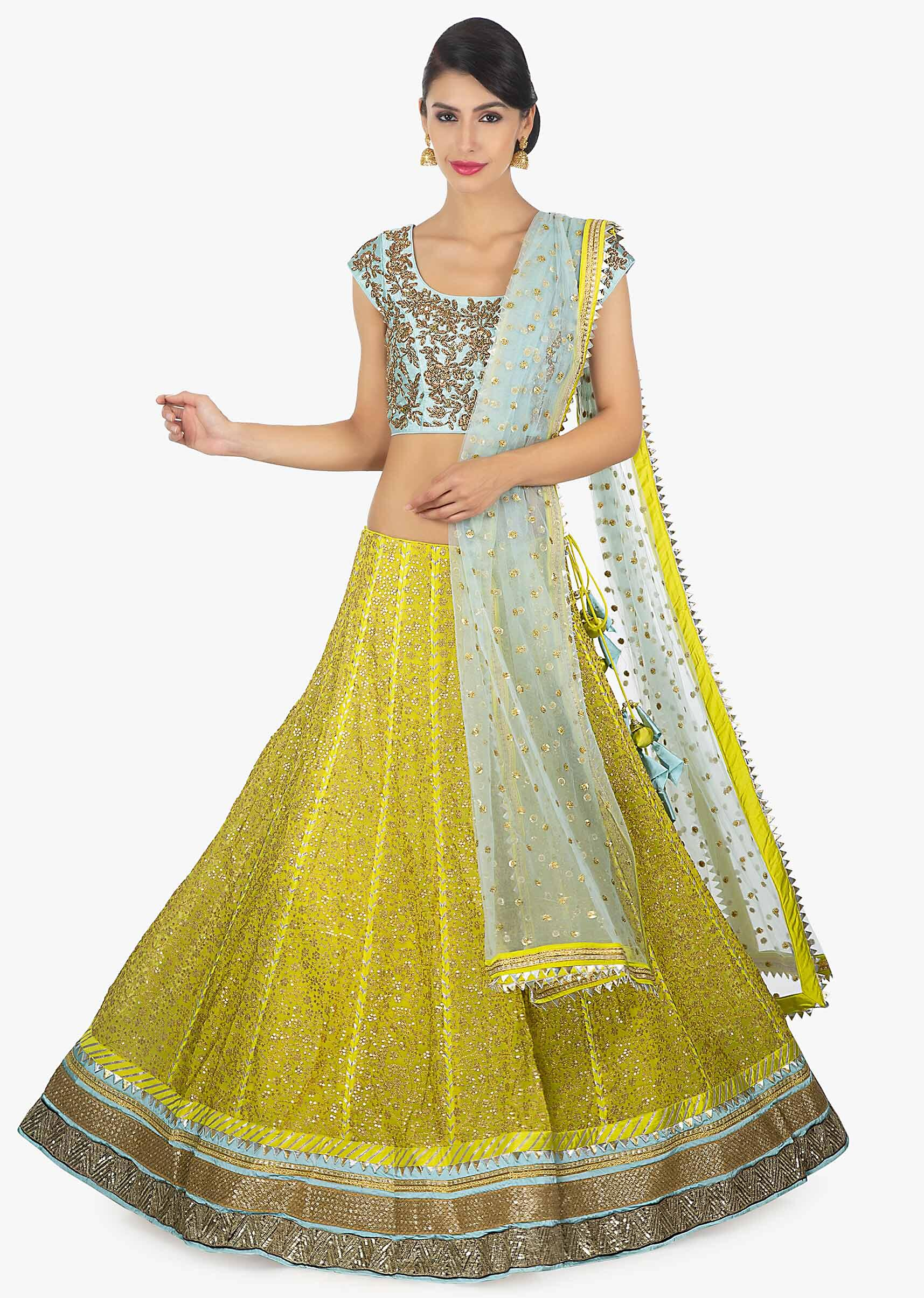 74550c4daf Sky blue raw silk embellished blouse paired with a canary yellow georgette  lehenga and net dupatta only on KalkiMore Detail