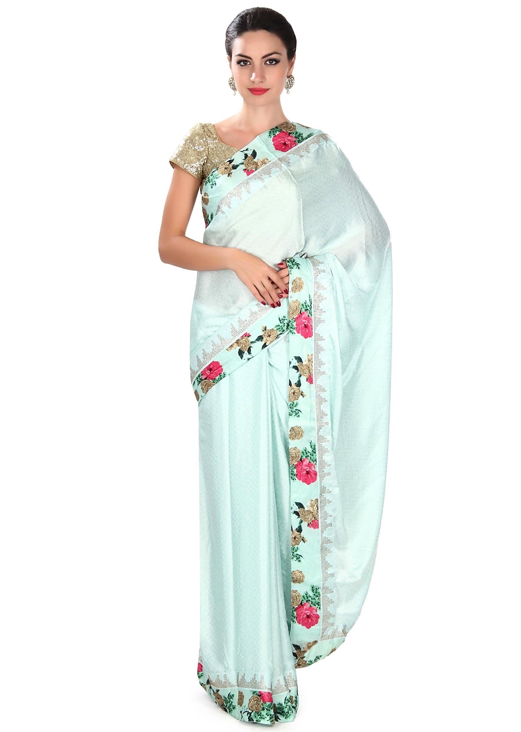 b1f8e4c6aef94 Angel blue saree adorn in floral and kundan border only on KalkiMore Detail