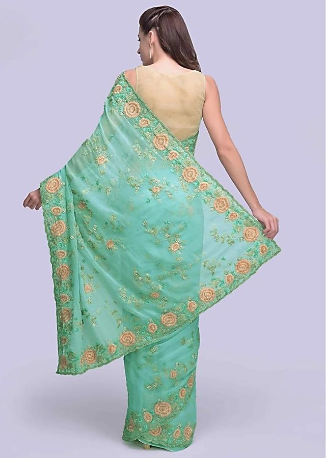 Sky blue georgette saree with floral  embroidered butti and border only on Kalki