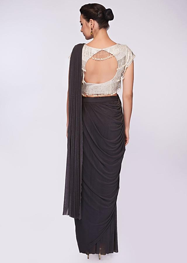 Smoke grey draped lycra saree paired with tasseled embroidered  blouse only on Kalki
