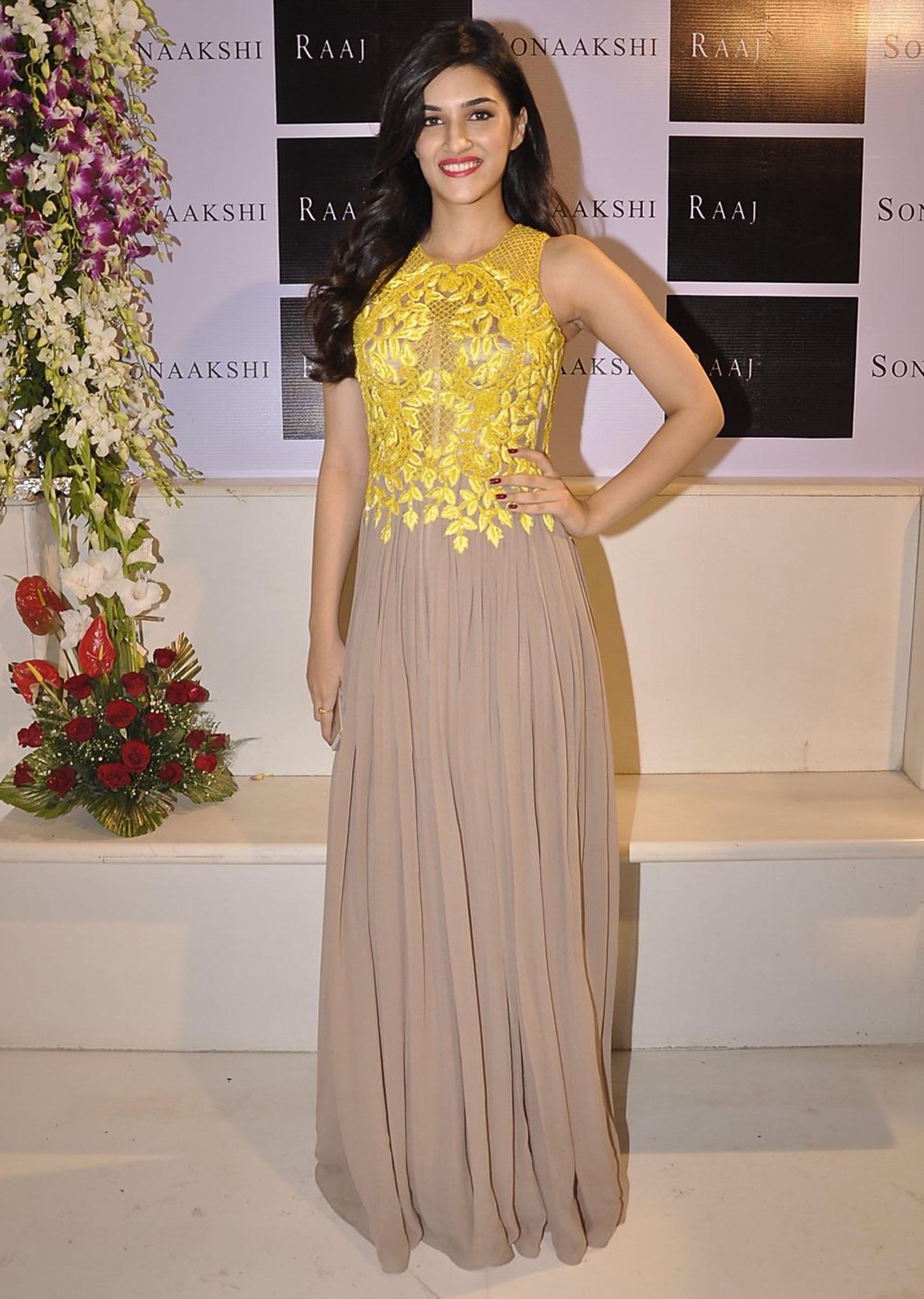 868aff91f2 Kriti Sanon was seen in a Sonaakshi Raaj's beige gown with yellow  embellishment at her new store launch.