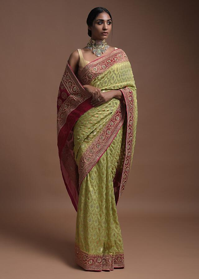Spring Green Banarsi Saree In Georgette With Weaved Floral Mesh And Floral Motifs On The Rani Pink Pallu Online - Kalki Fashion
