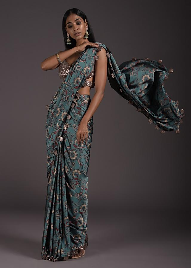 Steel Blue Floral Printed Saree In Satin With Sequin Fabric Tassels On The Border And Sequins Blouse With Cut Out Details Online - Kalki Fashion