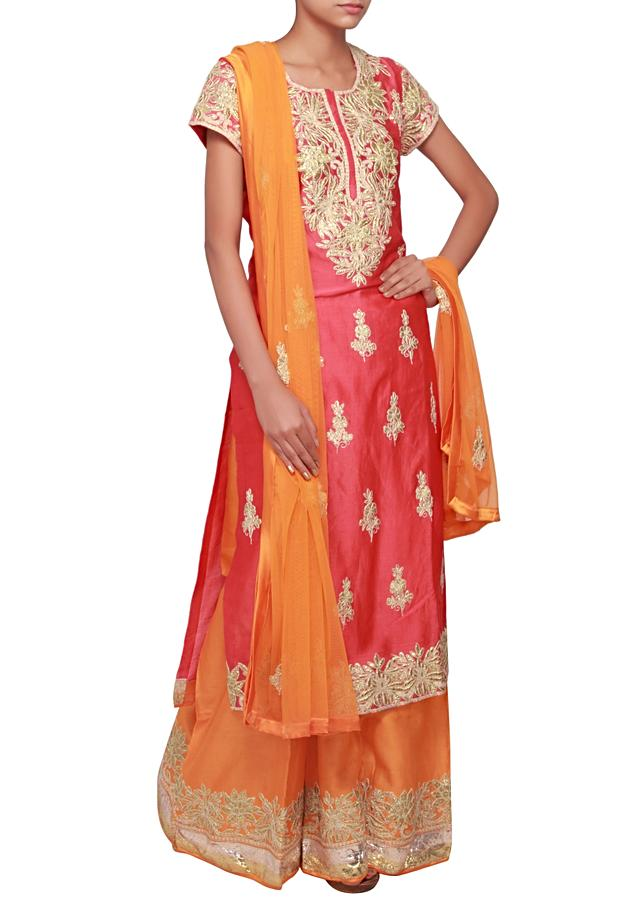Straight suit in coral matched with palazzo pants only on Kalki