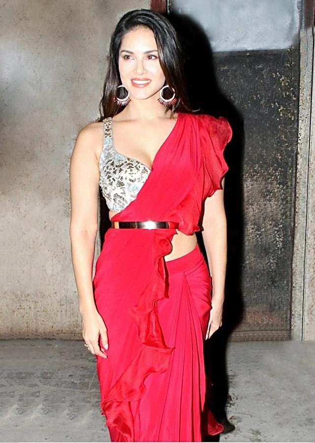 Sunny Leone In Kalki Scarlet Red Ruffle Saree And Embellished Silver Crop Top