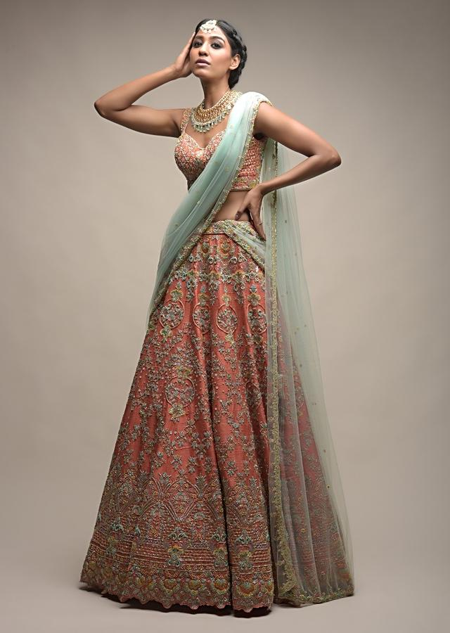 Tangerine Lehenga Choli In Raw Silk With Intricate Sequins And Cut Dana Embroidered Floral Blossoms Online - Kalki Fashion