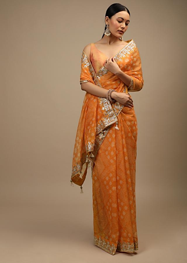 Tangerine Saree In Organza With Bandhani Print In Floral And Geometric Motifs Along With Gotta Patti Accented Border Online - Kalki Fashion
