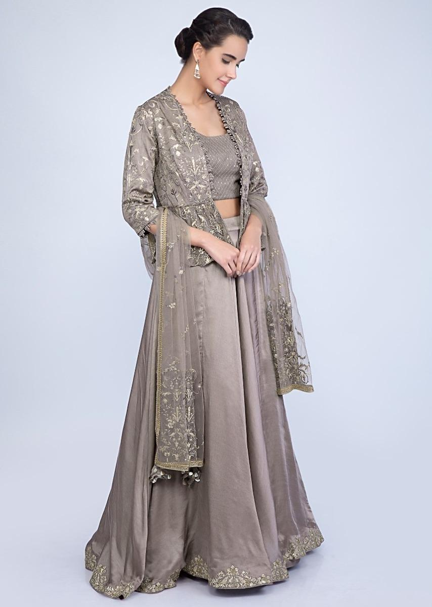 6908e5dd91 Taupe lehenga and blouse with matching embroidered net dupatta and a fancy  jacket only on Kalki