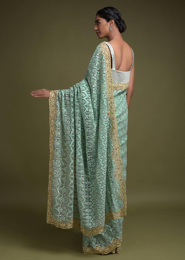 Tea Green Saree In Net Adorned With Turq Thread Embroidered Floral Heritage Pattern Online - Kalki Fashion