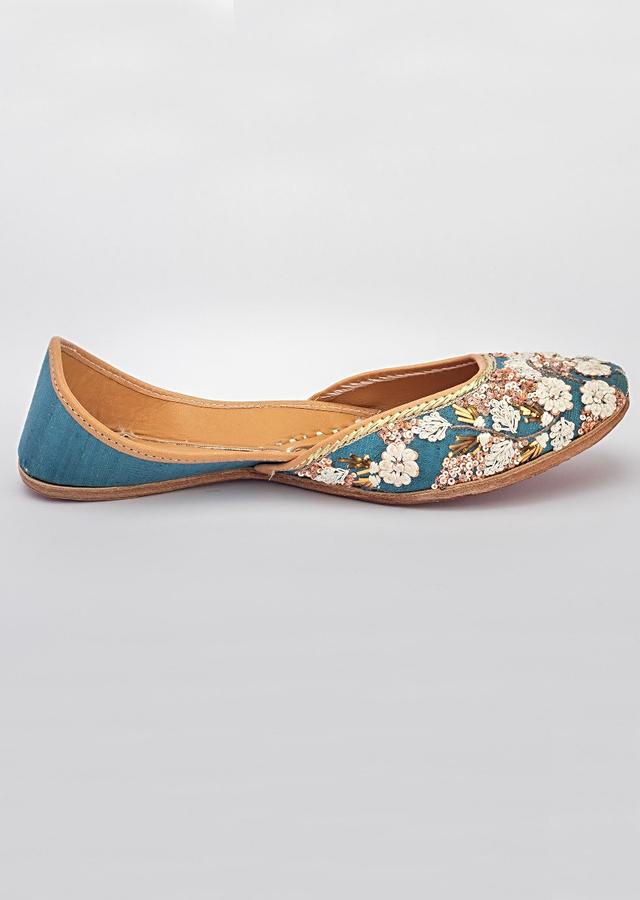 Teal Blue Juttis In Khadi Silk With French Knots, Dori And Badla Work In Floral Pattern By Vareli Bafna