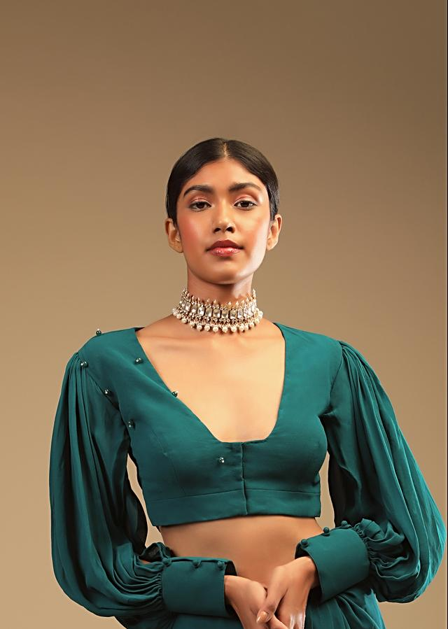 Teal Blue Saree In Georgette With Ruffle Frill, Bishop Sleeves Crop Top And A Chunky Embroidered Belt Online - Kalki Fashion