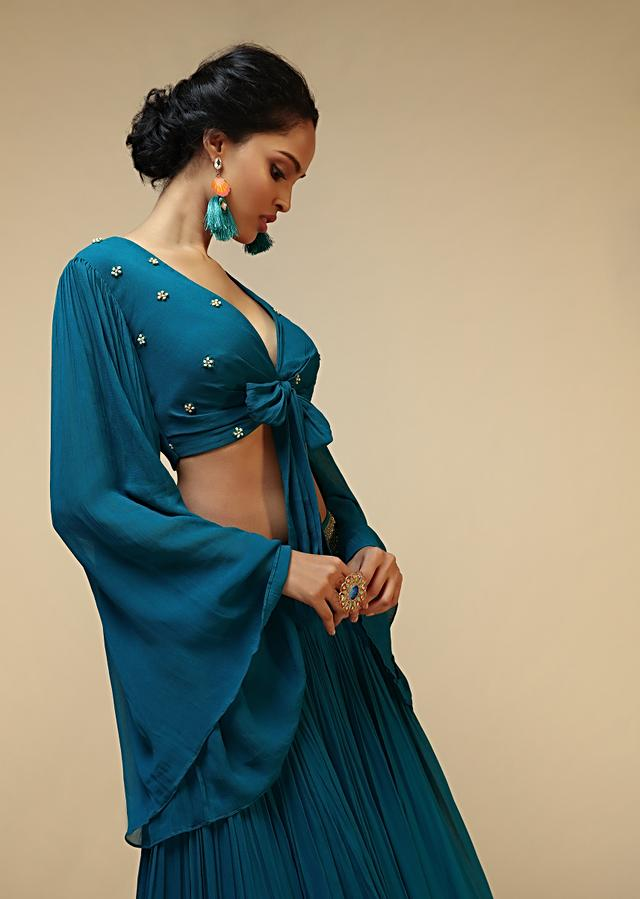 Teal Blue Skirt And Bell Sleeves Crop Top With Front Bow Tie Up Design And Multi Colored Sequin Embroidered Buttis Online - Kalki Fashion
