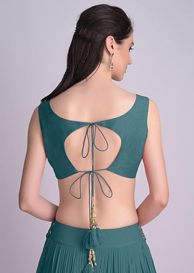 Teal Blue Sleeveless Blouse With Double Tie Up Tassel Dori At The Back Online - Kalki Fashion
