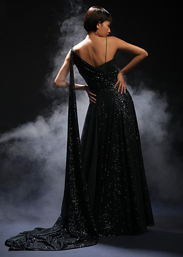Teal Gown In Sequins Fabric With Drape Design On The Bodice And Extended Cape On One Shoulder Online - Kalki Fashion