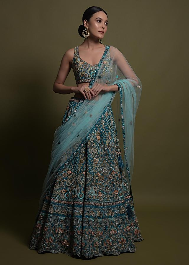 Teal Lehenga Choli In Raw Silk Hand Crafted With Embossed Embroidery In Heritage Floral Pattern Online - Kalki Fashion