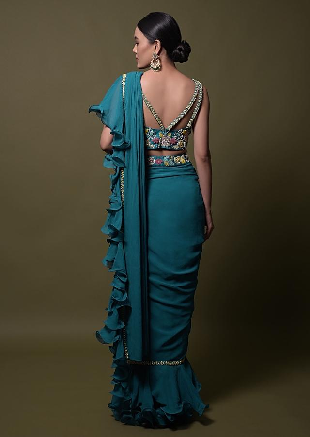 Teal ready pleated saree in georgette with ruffle frill and hand embroidered blouse online - kalki fashion