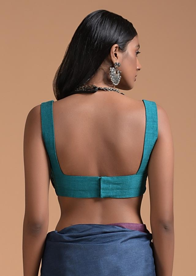 Teal Blue Sleeveless Blouse In Raw Silk With Fancy Curvy Square Neckline Online - Kalki Fashion