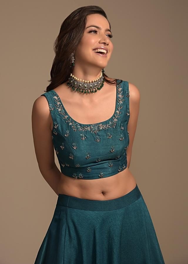 Teal Lehenga Choli In Raw Silk And Net Jacket With 3D Floral Embroidery Online - Kalki Fashion