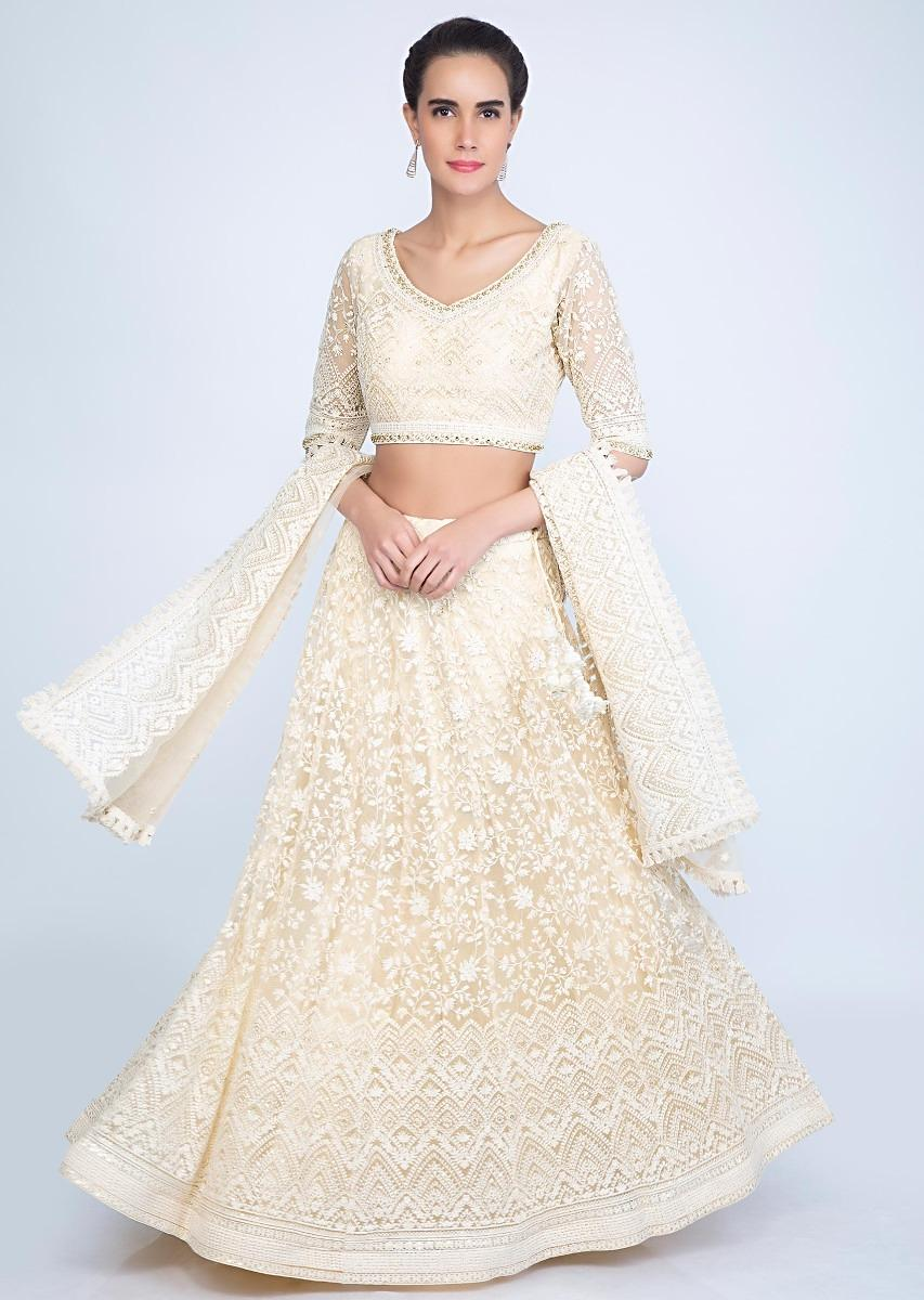 092892ac8d Thread embroiered cream lehenga set with satin underlayer only on kalkiMore  Detail