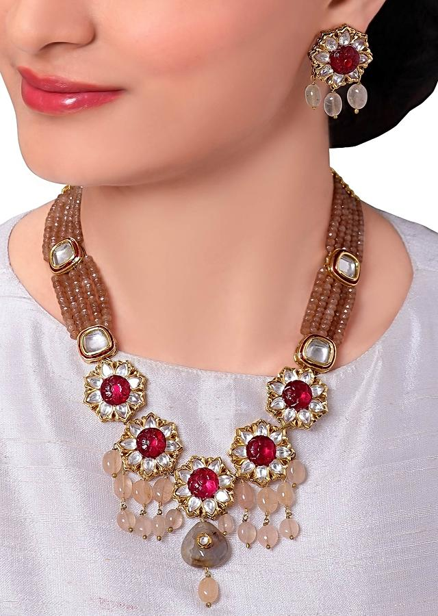 Traditional Kundan Necklace Set In Floral Design With Red Semi Precious Beads And Stones Online - Joules By Radhika