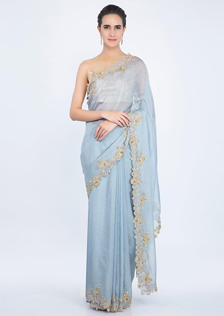 1d9732ec8fad9 True blue organza saree with zardosi floral embroidered border only on kalki