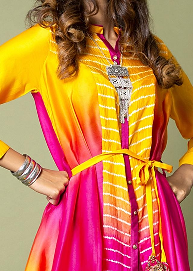 Turmeric Yellow And Hot Pink High Low Shirt With Bandhani And Water Color Effects Paired With Ivory Dhoti Pants Online - Kalki Fashion