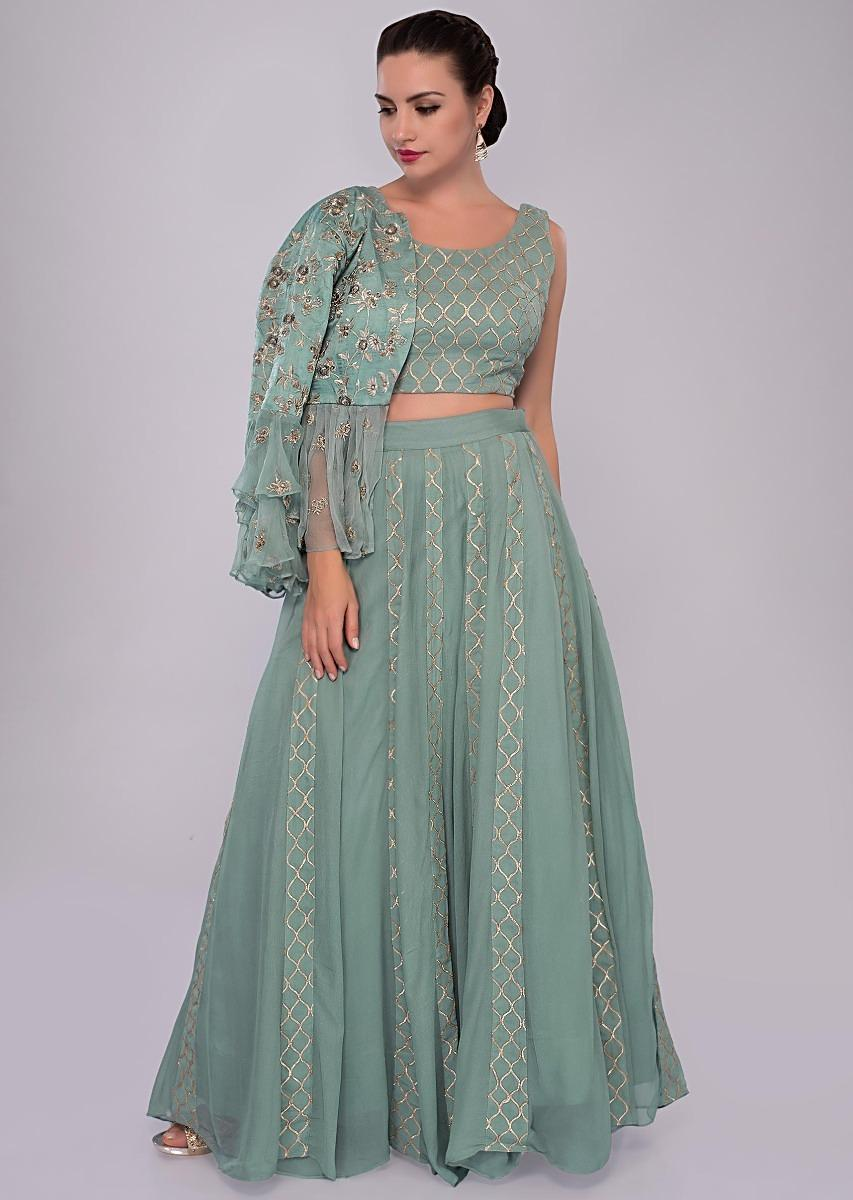 51f897e539082 Turq blue lehenga set paired with fancy jacket with frills and gathers only  on KalkiMore Detail