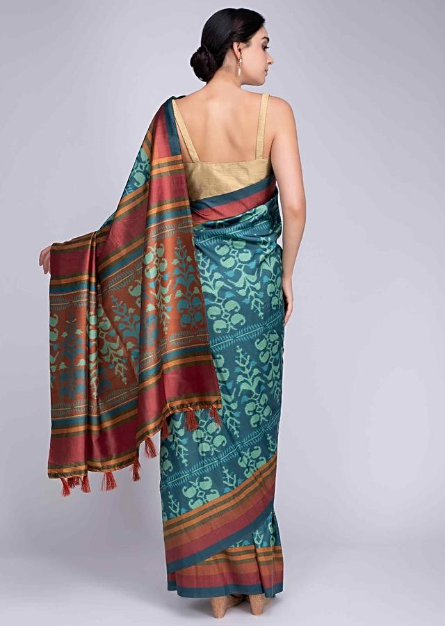 Turq blue silk saree in ikkat print and multi color striped only on Kalki