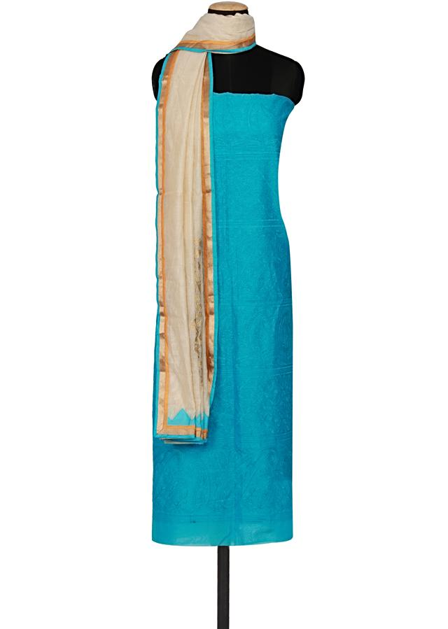Turquoise chanderi silk un-stitched salwar kameez embellished in thread embroidery  only on Kalki